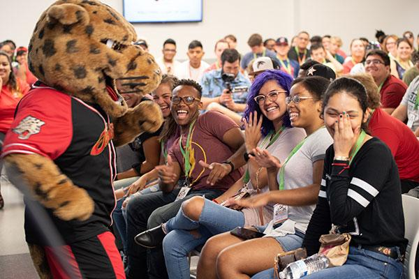jaX interacting with new students at UHV Homecoming Kickoff event.