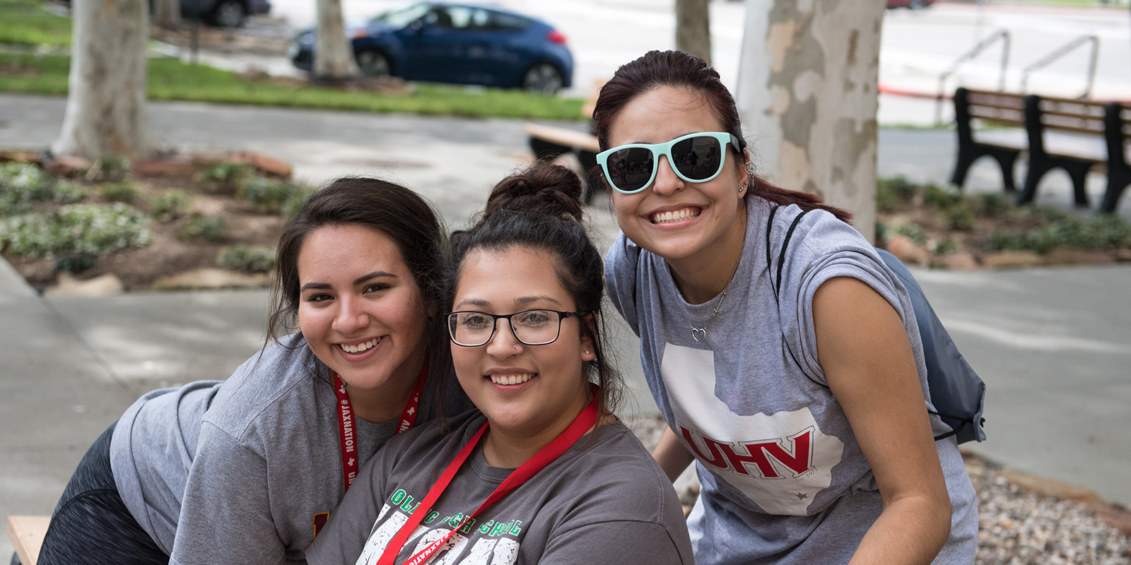 Three students pose together at UHV event