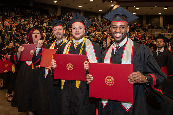 Four students graduating from UHV